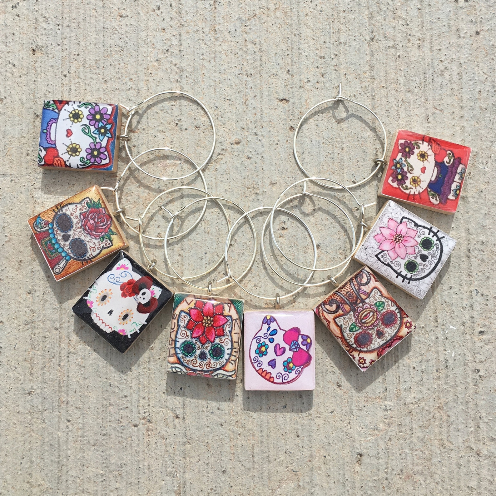 hello kitty day of the dead wine charms
